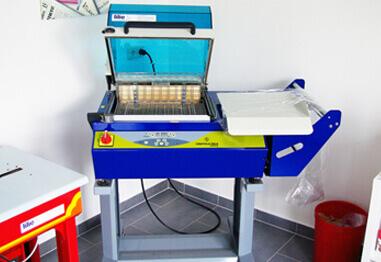 Haubenschrupfmaschine